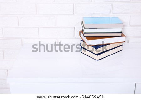 Books on the table in a class. Interior design. Copy space and selective focus