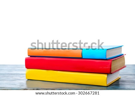 Books on the table with isolated background - stock photo