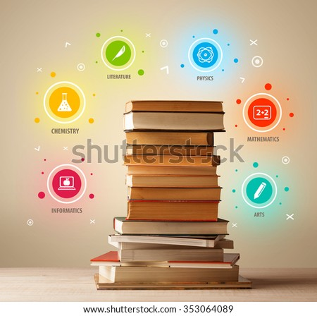 Books on top with colorful symbols on vintage old background - stock photo