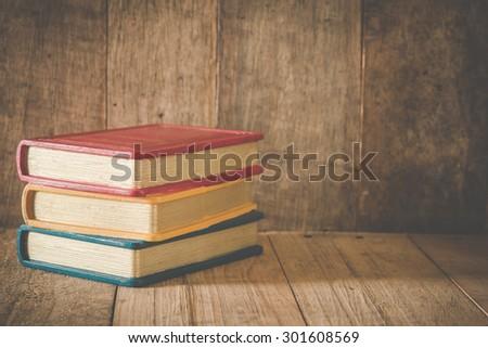 Books On Wooden Desk ,Vintage Style - stock photo