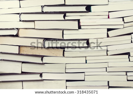 books on wooden planks background, vintage style - stock photo