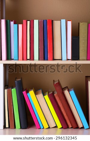 Books on wooden shelf.