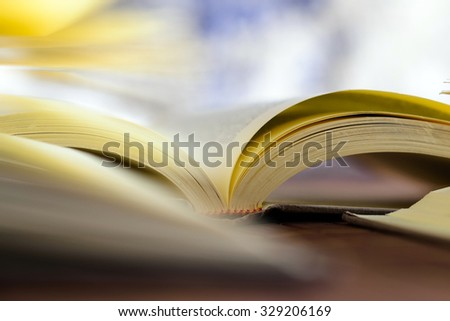 Books on wooden table - stock photo