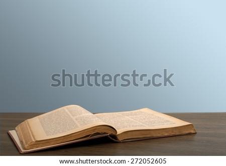 Books. Open book on the desk - stock photo