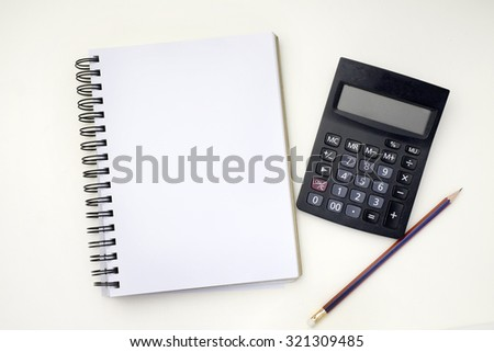 Books,pencils and calculator on table
