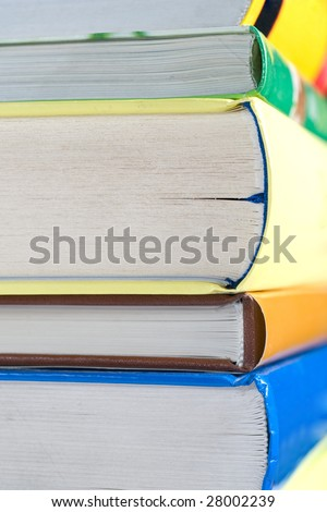 Books pile with close up of the paper edge - stock photo