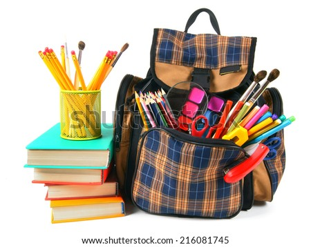 Books, school accessories and a backpack. On a white background. - stock photo