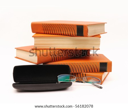 books stack and glasses isolated on white background - stock photo