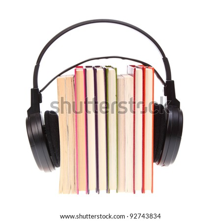 Books stack and headset isolated on white - stock photo