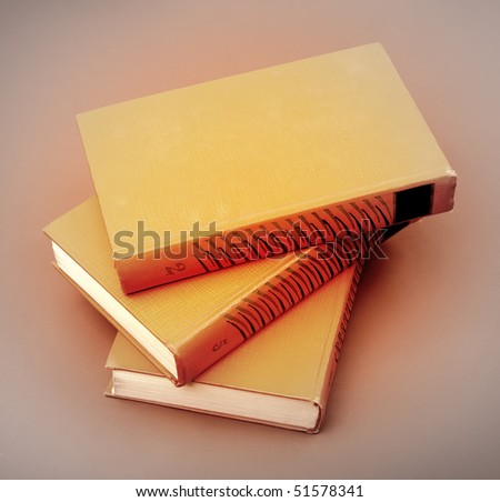 books stack on brown background - stock photo