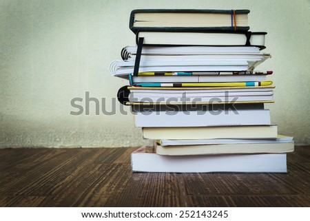 Books stacked on a wooden table