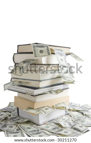 Books stacked on  top of one hundred dollar bills - stock photo