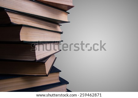 Books stacking. Back to school. Grey background.
