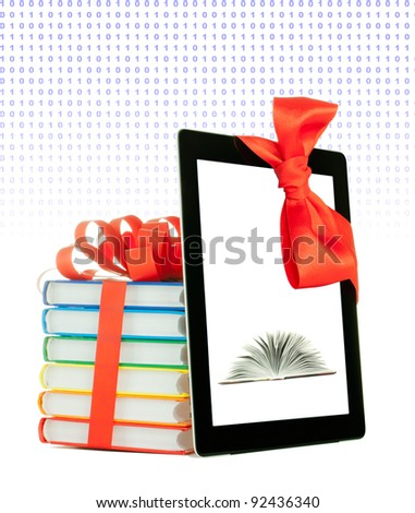 Books tied up with ribbon and tablet PC against white background - stock photo