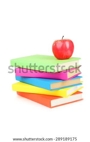 Books tower with apple isolated on white - stock photo