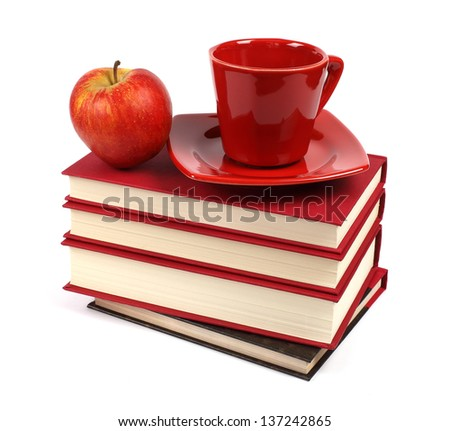 Books with apple and coffee cup isolated on white background