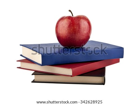 books with apples on a white background - stock photo