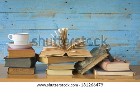 books with coffee cup,spectacles, magnifying glass, free copy space - stock photo
