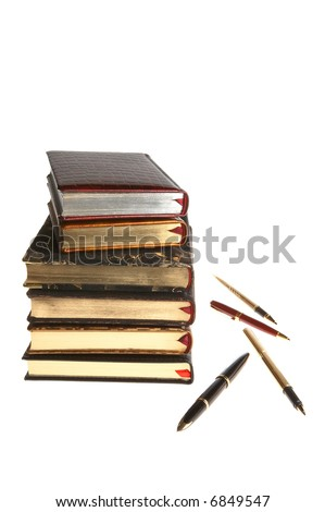 Books with gold and pens on a white background - stock photo