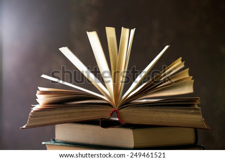 Books with light over dark background