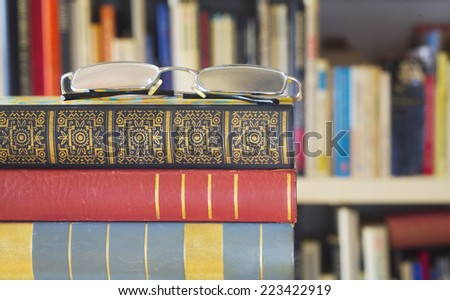 books with spectacles, library concept - stock photo
