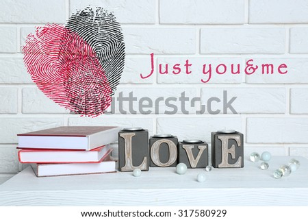 Books with word Love and fingerprint heart - stock photo