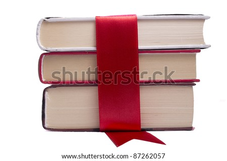 Books wrapped in red tape a white background over - stock photo