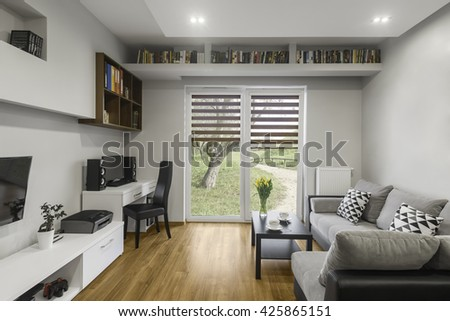 Bookshelf above window in modern living room