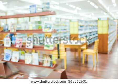 Bookshelf at library, interior blurred - stock photo