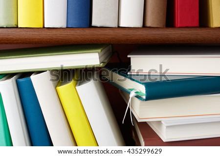Bookshelf full of colorful books. Close up of wooden bookshelf.  - stock photo