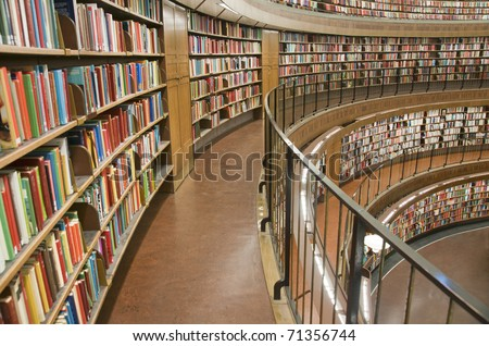 Bookshelf in library with many books - stock photo
