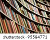 Bookshelf in library with many books. Shallow dof. - stock