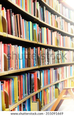 Bookshelf in public library, ladder - stock photo