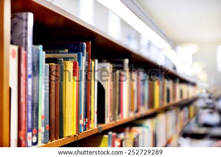 Bookshelf, interior blurred - stock photo