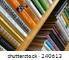 bookshelf with many colorful books - stock photo