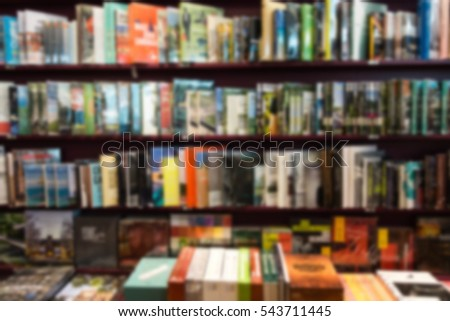 Bookstore blur background with miscellaneous books shelf, useful for educational concepts
