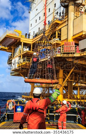 Boom lift people offshore oil into the cargo tanker. - stock photo