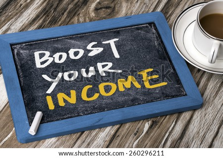 boost your income handwritten on blackboard - stock photo
