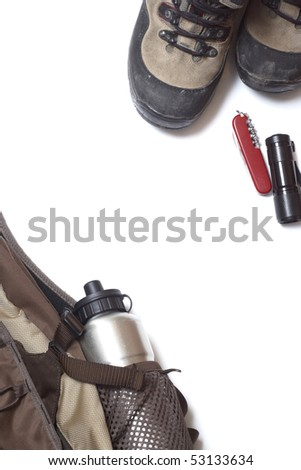 Boot, backpack, knife and flash-lamp