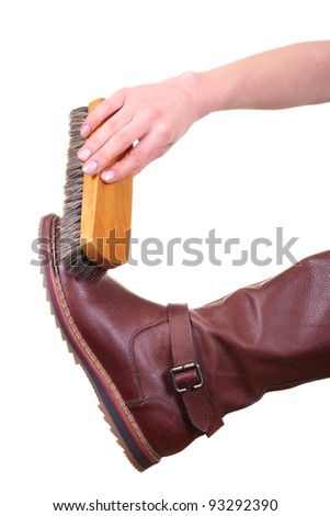 boot cleaning with brush isolated on white background - stock photo