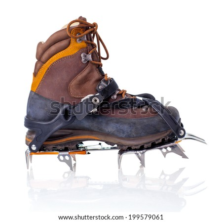 Boot with crampons isolated on white with reflection - stock photo