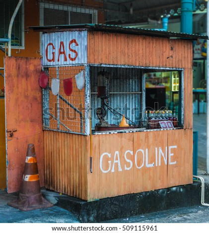 Booth with benzine in glass bottles. Gas station in Thailand