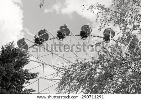 Booths old Ferris wheel closeup. Black and white. Krasnodar. Russia - stock photo