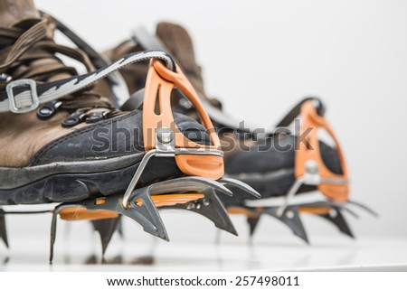 Boots and crampon. - stock photo
