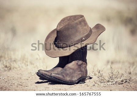 Boots and hat, old style processing - stock photo