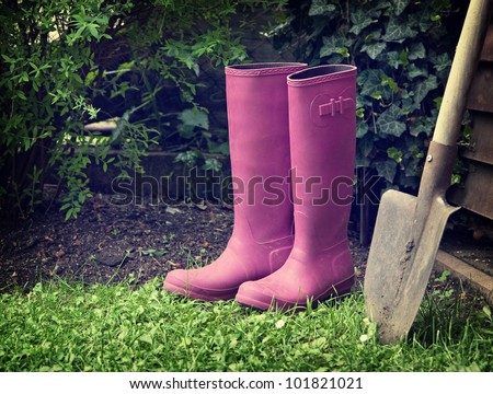 boots and spade in garden - stock photo