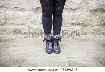 Boots female legs, detail of winter boots, fashion and comfort - stock photo
