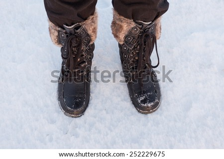 Boots in the Snow - stock photo