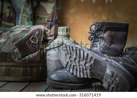 boots of soldiers placed on a wooden - stock photo