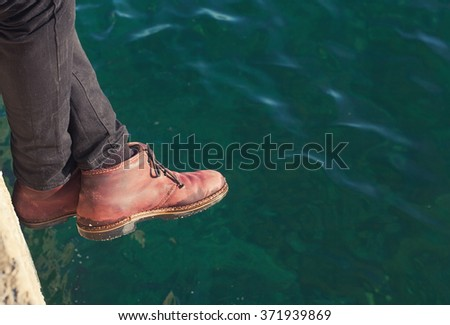 boots over the sea - stock photo